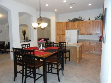 Open concept kitchen that is fully equipped and lots of room to prepare a meal
