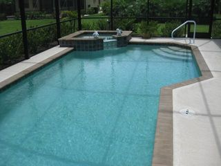 Estero house photo - Heated pool with spa and child safety fence