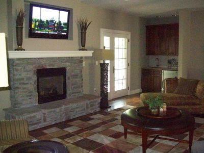 Living room (note flat screen tv, fire place, wet bar)