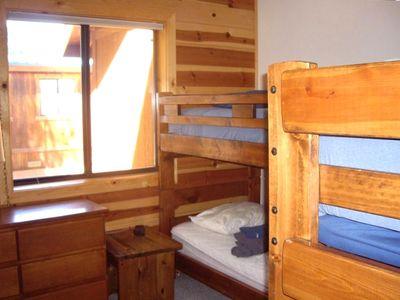 Downstairs bedroom with two sets of bunk beds