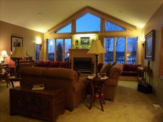 Amery house photo - Main level living room with view