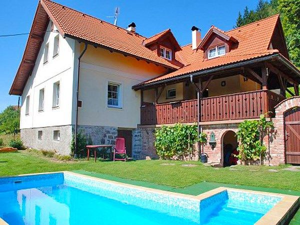 Holiday house with sauna and outdoor swimming pool