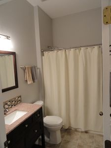 Beautiful guest bath with tub/shower combo. Its located beside the 2 guest rooms