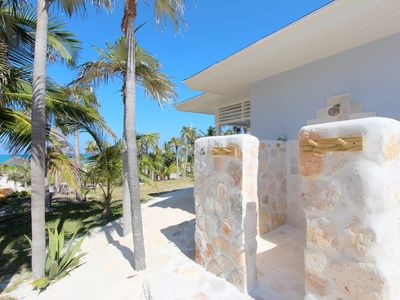 Guest Cottage 1: Outdoor shower. Relax after a hard day on the beach!