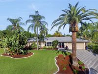 Waterfront Home in Yacht Club with Close Gulf Access, Boat Dock, Heated Pool
