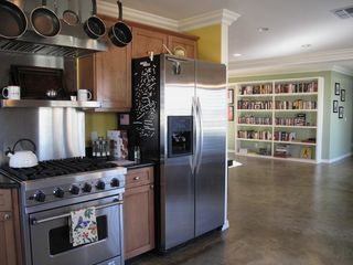 Kitchen fully-equipped with a Viking range, dishwasher and other amenities.