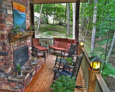 You'll spend all your time here - covered porch, fireplace, lots of seating.