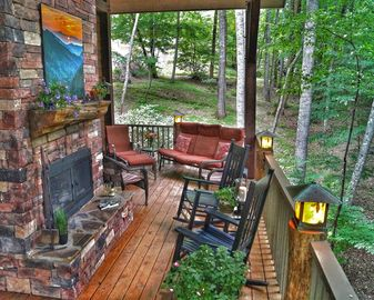 Franklin house rental - You'll spend all your time here - covered porch, fireplace, lots of seating.