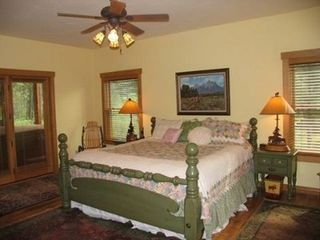 Jackson Hole house photo - Main floor master bedroom with door to porch and spa plus luxurious bath