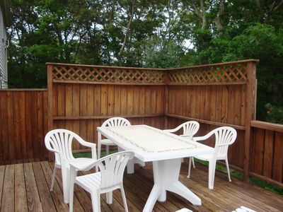 Deck dining - large umbrella, additional seating and lounge chairs and gas grill