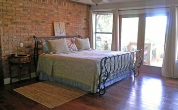 Splendid Master Bedroom with it's own outdoor deck and wood floors