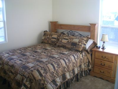 Queen bed with pillow top mattress