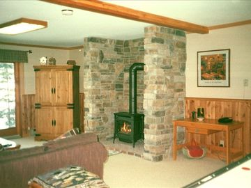 Relax and enjoy the fire or walk out to the lake from the downstairs family room