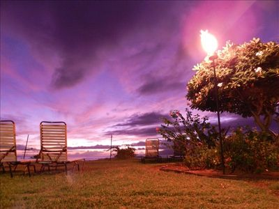 Tiki torches light up the landscaped oceanfront grounds. Another amazing sunset!