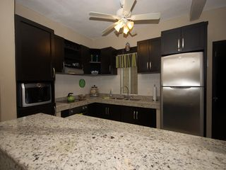 Playacar condo photo - Open kitchen with granite breakfast bar.