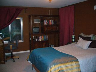 Littleton house photo - large bedroom in basement area, full size bed, full bathroom also in basement