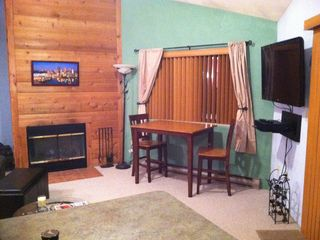 Hidden Valley cabin rental - Living Room with Plasma TV, wood burning fireplace and table overlooking slopes
