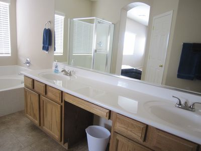 Master bath is spacious with dual vanity, soaking tub, shower and toilet...