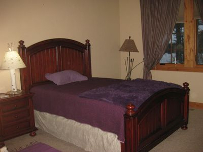 Guest room with queen bed in winter