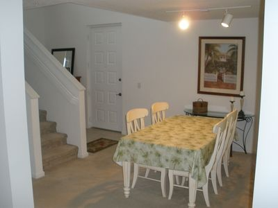 Condo entrance and dining area