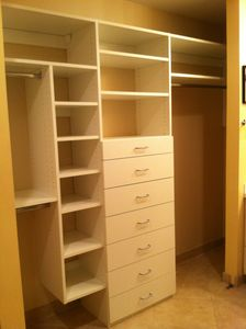 New closet organizer in the dressing room / bathroom area.