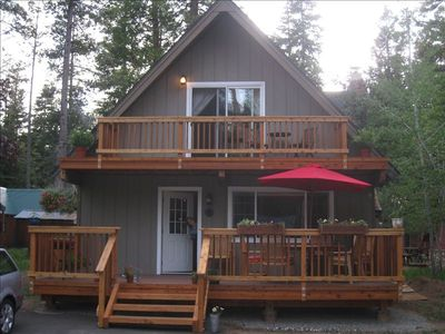 Sunny Deck with large table and umbrella, upstairs deck with adirondack chairs