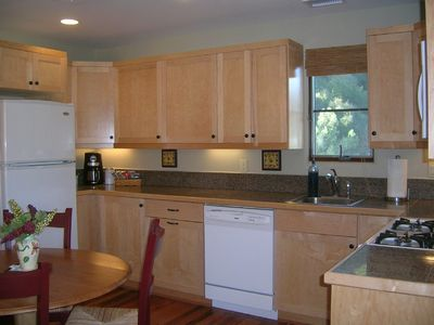 A closer look at kitchen with gas range, dishwasher, frig with icemaker & more!