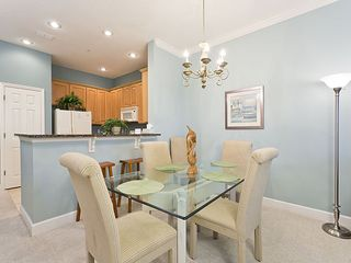 Ormond Beach condo photo - Our beautiful new dining table and breakfast bar with stools