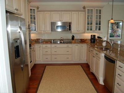 Gourmet kitchen with granite countertops & stainless appliances