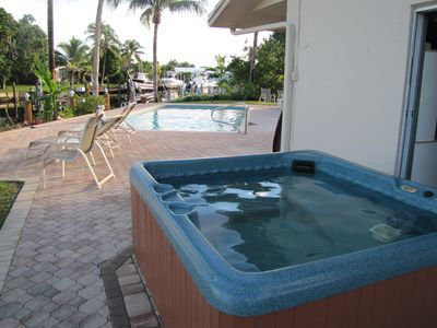 Enjoy the hot tub and pool with  a fabulous view of the waterfront.  Incredible!