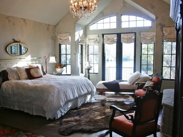 Master suite boasts a marble fireplace, flat screen t.v. & beautiful lake view.