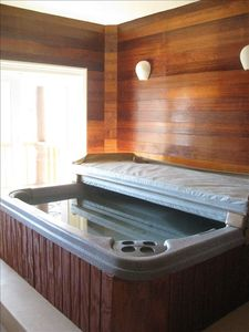 INDOOR JACUZZI ROOM! With granite counter and flooring, and beautiful lake views