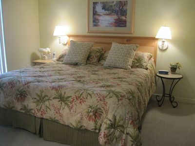 King Tempurpedic-Like Mattress. Tommy Bahama Bedding. Glass door to bacony