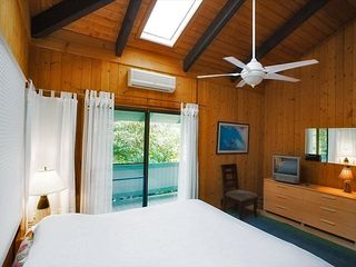 Haleiwa house photo - Second bedroom upstairs with King bed, sky lights
