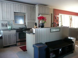 Ossipee Lake house photo - Kitchen & large eating area door Sunroom on right end of counter