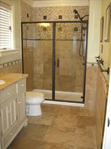 Master bathroom has walk-in shower with body sprays.