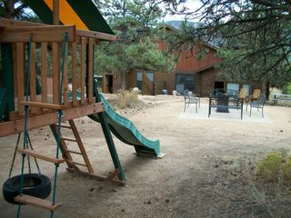 Estes Park condo photo - Commons Area-Fire pit, Horse shoes, Kids play area, Picnic tables, Lounge chairs