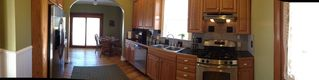 Colorado Springs house photo - Gourmet kitchen with stainless appliances, granite counter tops and backsplash.