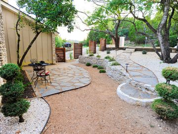 Front courtyard area with shaded bistro set