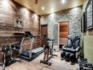 Recreation Room  - Recreation room with a multi person sauna, weights, treadmill, workout bike, and a massage chair!