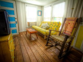 Tybee Island cottage photo - First floor livingroom with another comfortable futon, TV and rocker
