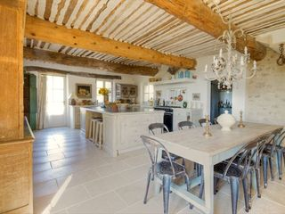Gordes farmhouse photo - Dream Kitchen with Central Island and Dining Area