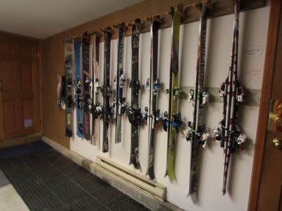 Store skis, boots on boot warmer, poles, helmet in large heated garage/mud room