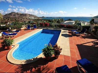 Beautiful views from patio, pool and spa overlooking Orient Bay and mountainside