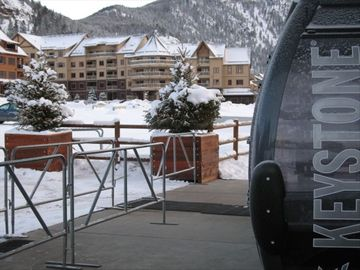 Keystone condo rental - Our Red Hawk building shown right behind River Run gondola!