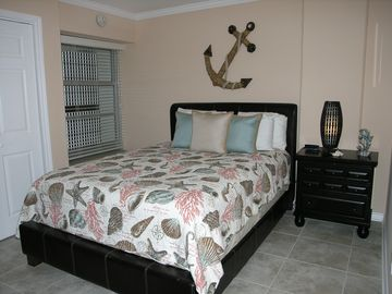2nd Bedroom with queen bed and pillow top mattress. Beach decor.