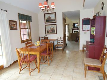 Dining side of 11 x 24 kitchen, sits 10 w island stools