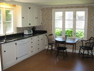 Newly rennovated country, eat-in kitchen with fireplace.