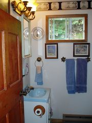 Ingonish cottage photo - Full bathroom including bathtub and shower.