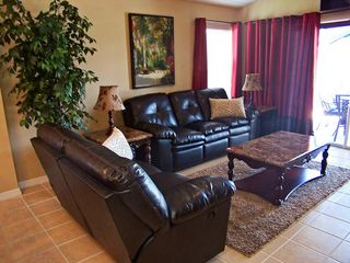 Family Room (8 Place Reclining Sofas) - Highgate Park villa vacation rental photo